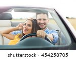 couple enjoying a drive in a... | Shutterstock . vector #454258705