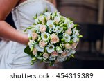 round bouquet of small roses in ... | Shutterstock . vector #454319389