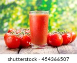 Glass Of Tomato Juice On Wooden ...