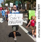 Small photo of BOISE, IDAHO-JULY 16 2016: Man holding the sign with the last words of Eric Garner during a boise BLM Rally