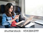 cute asian woman using... | Shutterstock . vector #454384399