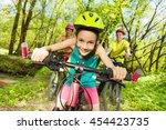 cute girl riding her mountain... | Shutterstock . vector #454423735