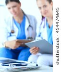 two young women doctors sitting ... | Shutterstock . vector #454474645