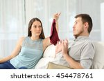 wife finds panties on a sofa... | Shutterstock . vector #454478761