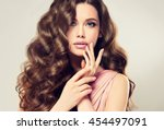 brunette  girl with long   ... | Shutterstock . vector #454497091