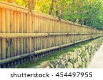 Bamboo Fence On Stone With...