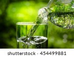 drink water pouring in to glass ... | Shutterstock . vector #454499881