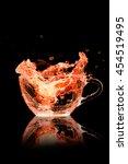 cocktails orange splash out of...   Shutterstock . vector #454519495