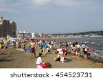 Small photo of Lots of people are enjoying in Enoshima beach in Marine Day (Ocean Day or Sea Day) on 18 July 2016 as this is National holiday in Japan and this day is celebrate every year on third month of July.