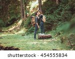 couple of hikers hiking with... | Shutterstock . vector #454555834