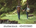 a couple hikers hiking with... | Shutterstock . vector #454555885