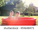 child splashing in the bath... | Shutterstock . vector #454648471