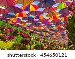 Small photo of UAE, DUBAI - DECEMBER 30: multicolor umbrellas roof in Dubai miracle garden on December 30, 2014