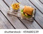 Fries And Burger On Board. Bun...