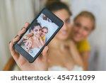 bride and her wedding assistant ... | Shutterstock . vector #454711099