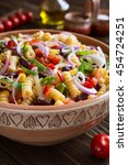 Small photo of Vegetarian Mexican macaroni pasta salad with red bean, corn, tomato, onion and pepper