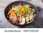 soba wok noodles with meat and... | Shutterstock . vector #454733239