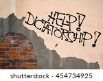 Small photo of Help! Dictatorship - Handwritten graffiti sprayed on the wall, anarchist aesthetics - danger of authoritarian, absolutist, dominant ruler and his / her repressions, oppression and control