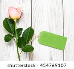 pink rose and green tag on a... | Shutterstock . vector #454769107