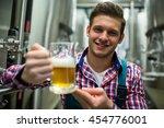 portrait of brewer holding a... | Shutterstock . vector #454776001