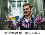 portrait of brewer holding a... | Shutterstock . vector #454776577