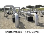 Pipes, flanges and gas sensors of an LPG station. - stock photo