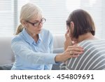 Therapist Comforting Patient On ...