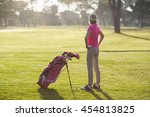 rear view of mature golfer with ... | Shutterstock . vector #454813825