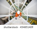process engineer climb up to... | Shutterstock . vector #454851409
