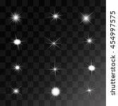set of vector glowing light... | Shutterstock .eps vector #454997575
