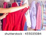 young woman choosing red dress... | Shutterstock . vector #455035084