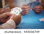 Retired people playing card in...
