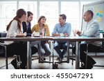 coworkers discussing in meeting ... | Shutterstock . vector #455047291