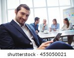 portrait of smiling businessman ... | Shutterstock . vector #455050021