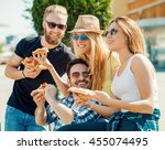 close up of four young cheerful ... | Shutterstock . vector #455074495