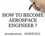 "Small photo of Handwriting "" how to become aerospace engineer ? "" with the hand and pen isolated in white background."