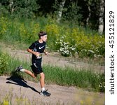 Small photo of Beaver Creek, Colorado, USA - July 17, 2016: Reese Hathaway, competing in the male 10-14 age group, runs to a ninth place finish in the XTERRA Beaver Creek 10K Trail Run.