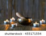 singing bowl on dark wooden... | Shutterstock . vector #455171554