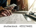 two colleagues discussing data... | Shutterstock . vector #455174401