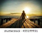 girl in denim dress sitting on... | Shutterstock . vector #455199931