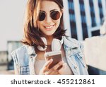 happy beautiful girl using... | Shutterstock . vector #455212861