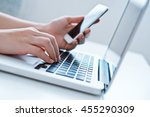 woman's hands using laptop and... | Shutterstock . vector #455290309