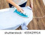 closeup of woman ironing... | Shutterstock . vector #455429914