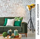 green sofa stone wall with... | Shutterstock . vector #455452039
