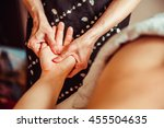 physical therapist massage... | Shutterstock . vector #455504635