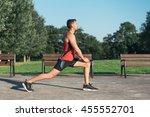 fitness man stretching legs... | Shutterstock . vector #455552701