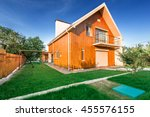 wooden house with meadow in... | Shutterstock . vector #455576155