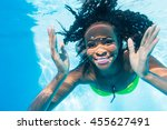 black girl diving in swimming... | Shutterstock . vector #455627491