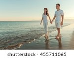 young couple holding hands... | Shutterstock . vector #455711065