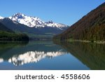 Mountain, lake and reflection - stock photo